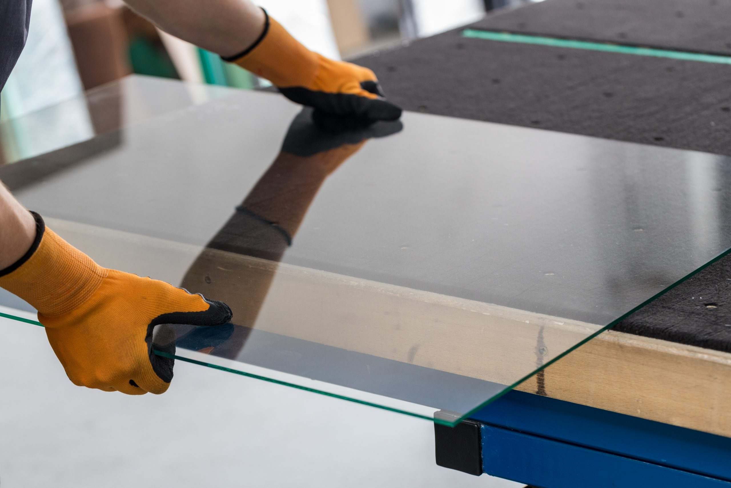 Glass factory, Glazier lifting that table glass