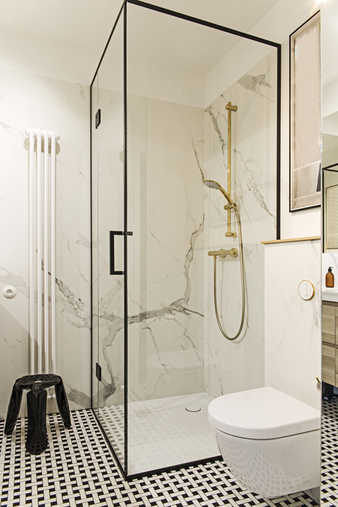 Cozy and stylish bathroom with white walls and design accessories.