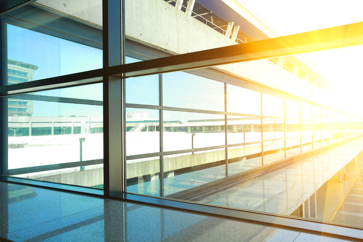 golden sunlight blue of glass windows in modern office building